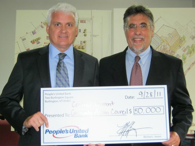 BIG CHECK — People's United Bank pledged $50,000 to Central Vermont Community Action Council's Community Action Campus building project in Vermont. Founded in 1965, Community Action helps Vermonters achieve economic sufficiency with dignity through individual and family development.   Pictured are Michael Seaver, president of People's United Bank in Vermont, and Community Action's Executive Director Hal Cohen.