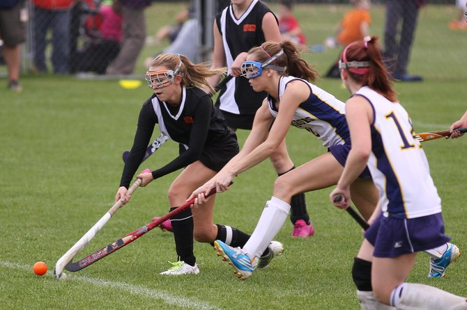 Warrensburg Field Hockey player Korynn Raymond  pursues the ball during the recent game versus Corinth which resulted in the Burghers capturing the Adirondack League Championship. This was a turnaround year for the Burghers, who endured a 0-6 record in 2011, but worked hard to earn a 6-0 record in 2012. Coach Mary ann Bump predicted this week the team will have a stellar season in 2013.