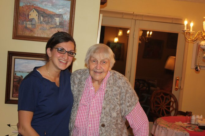 Jamla Rizek, RN and WAVES member, poses with Camillus resident Gertrude Hoenig following the first fall and injury prevention visit.