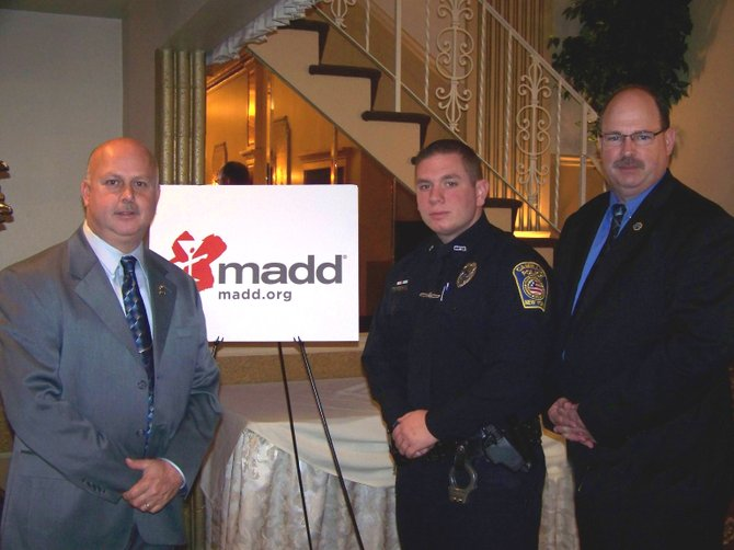 (From left) Camillus Captain Steve Rotunno, Officer James Pollard and Chief Thomas Winn are pictured at the annual MADD — STOP DWI awards luncheon.