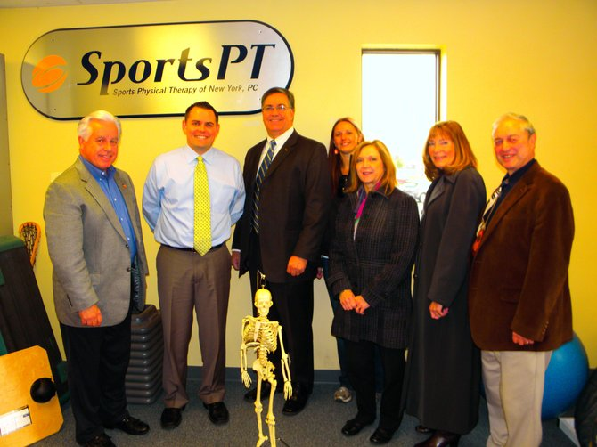 Sports Physical Therapy manager Drew Jenk, second from left, is pictured with the Greater Camillus Chamber of Commerce.