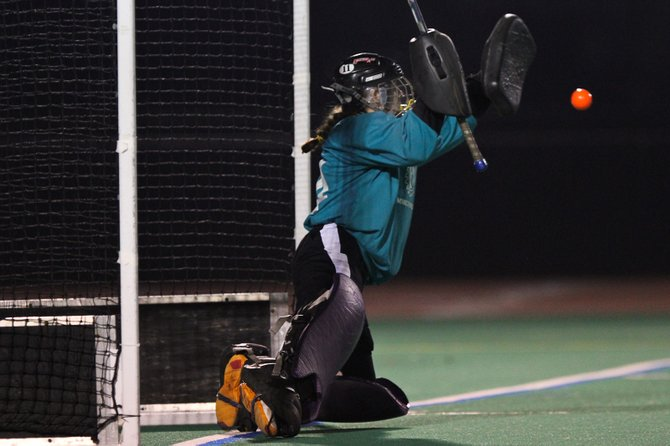 Liverpool field hockey goalie Megan Evangelista makes a key save in penalty strokes, which helps her side beat Niskayuna in Saturday&#39;s state Class A semifinal at Bragman Stadium after the two sides played through regulation and overtime in a 2-2 tie.