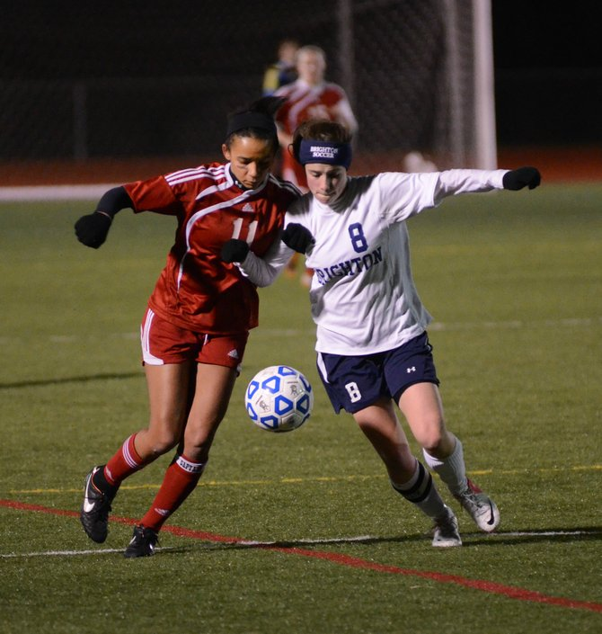 Jamesville-DeWitt senior midfielder Jessica Holmes (11) battles with Brighton's Carrie Leyens for the ball in Saturday night's state Class A semifinal at SUNY-Cortland. Holmes landed the only goal in the Red Rams '1-0 victory over the Barons.