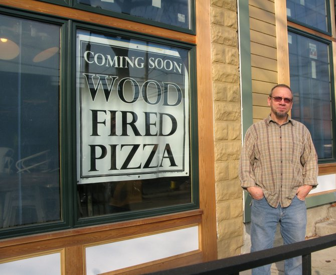 John Freightenburgh, owner, stands outside Ironwood, the wood-fired pizza shop he's opening in the village of Manlius.