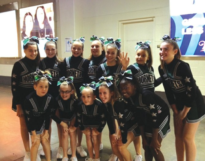 Pictured from left are members of the FM Pop Warner Pee Wee cheer team, which qualified last weekend for the Pop Warner National Cheer & Dance Competition, back row: Lauren Westfall, Erianna Madill, Emmi Lingel, Cally Hendry, Erin Quigley, Alle Inzinna and Sally Rosenholm; front row: Caleigh Dutton, Abby Gelatt, Cassidy Wing, Grace Weisiger and Kiarra Kurd.