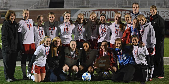 Jamesville-DeWitt's girls soccer team with the second-place championship plaque after Sunday night's state Class A final. Though the Red Rams lost to Long Island power South Side 2-0, it still progressed further than any team in the program's history, and did so with only two seniors (Maddy Devereaux and Jessica Holmes) on the roster.