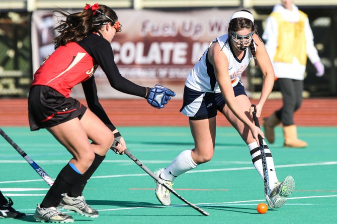 Liverpool senior midfielder Emily Burns (15) tries to work around a Sachem East defender in Sunday's Class AA state final at Bragman Stadium. The Warriors lost, 3-0, to the Flaming Arrows, who won its second consecutive state title.