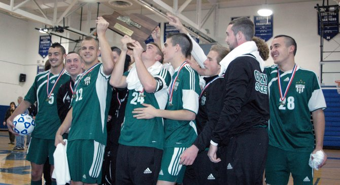 The Chazy Eagles celebrate receiving the 2012 NYSPHSAA Class D championship trophy.
