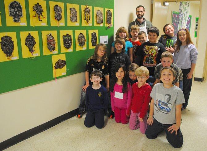 Art teacher John Brodowski and third-grade students proudly display metal face masks made during art class at Neshobe Elementary School this semester.