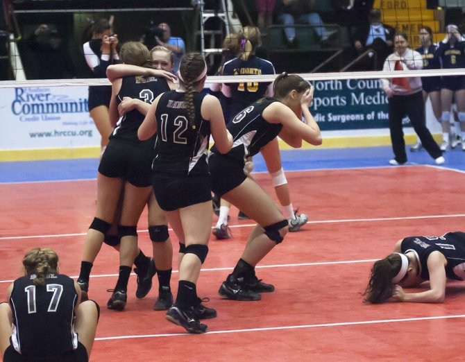 The Burnt Hills-Ballston Lake girls volleyball team reacts after beating Pittsford Sutherland 3-1 in Sunday's Class A state title match at the Glens Falls Civic Center.