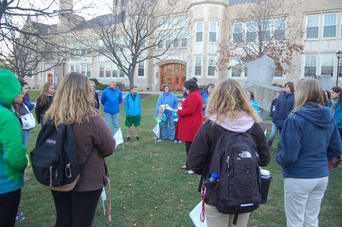 People gather at Plattsburgh State, dressed in blue and standing in a circle, to raise awareness about diabetes.