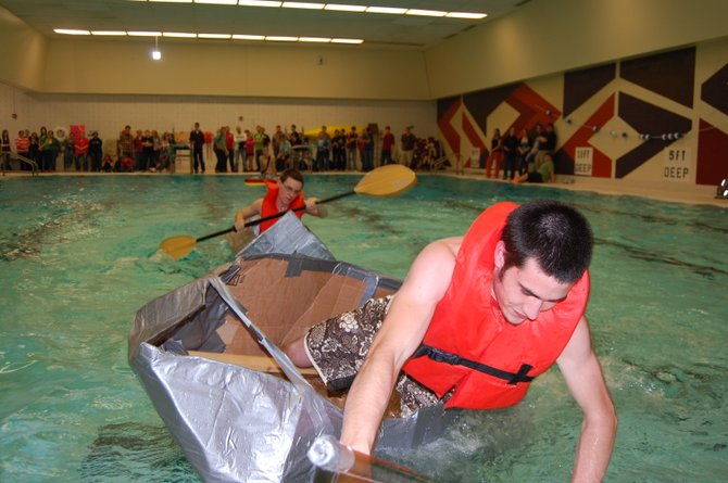 Students from Northeastern Clinton Central School and Chazy Central Rural School participate in cardboard boat races as part of a project for their technology classes