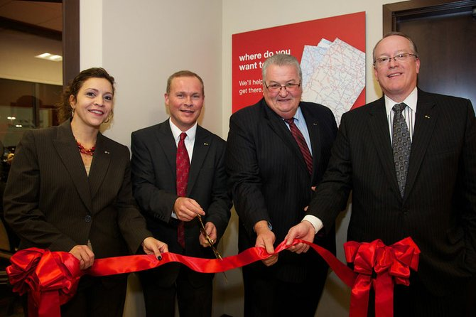 From left, vice president Helene Winnewisser, branch manager Kevin Holmquist, SVP Mike McMahon and president Steve Fournier cut the ribbon on the new KeyBank at 7670 Highbridge Road.