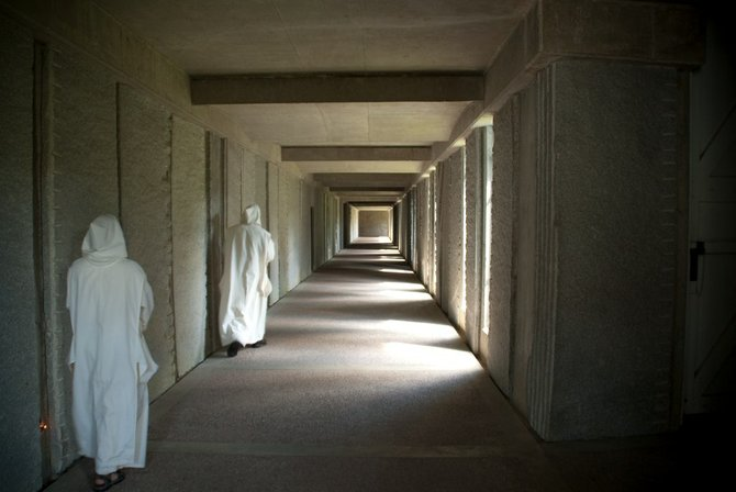 Monks walk through a corridor of silence at an isolated Catholic monastery at the foot of Mt. Equinox.