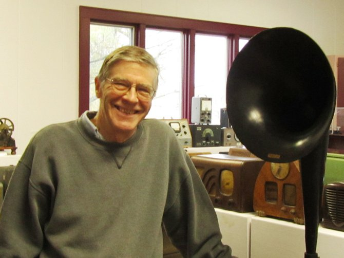 """Local resident Bob Chevako is pictured with a device known as a Western Electric """"speaker.""""  Chevako's personal collection of """"Past Technology"""" will be available for group tours and special viewings until the exhibit closes Nov. 28."""