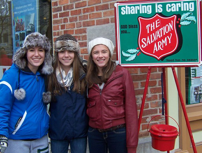 Meghan, Julia and Kaleen Allyn volunteered as bell ringers during last year's Dickens Christmas.