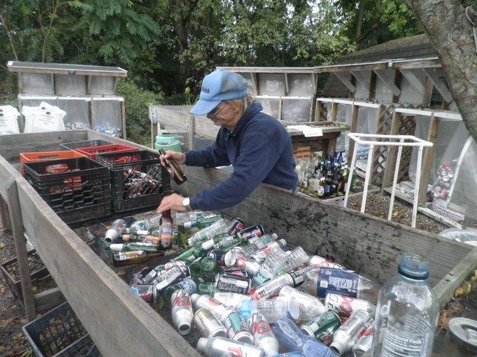 Paul, a volunteer at the Mohawk Hudson Humane Society, sorts bottles as part of the nonprofit's Empties for Animals program.