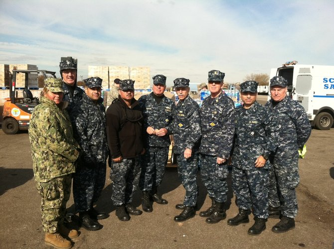 David Tucker, fifth from left, stands with officers at Floyd Bennett Field in Brooklyn where he assisted in Sandy relief efforts.