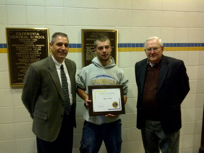 Cazenovia Lions Club September Student of the Month Ryan OHerien, center, stands between Cazenovia High School Principal Eric Schnabl and Tom Long, membership chairperson for the local Lions Club.