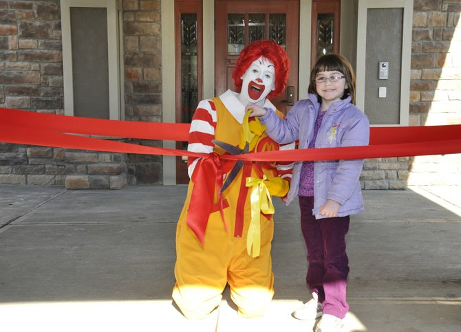 Ronald McDonald and Victoria Tillinghast, a former guest of the CNY Ronald McDonald House, cut the ribbon. 