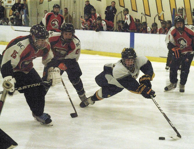 Shaker/Colonie&#39;s Mike Minneau falls as he brings the puck into Bethlehem&#39;s zone during Saturday&#39;s S/C Thanksgiving Tournament consolation game at the Albany County Hockey Facility.