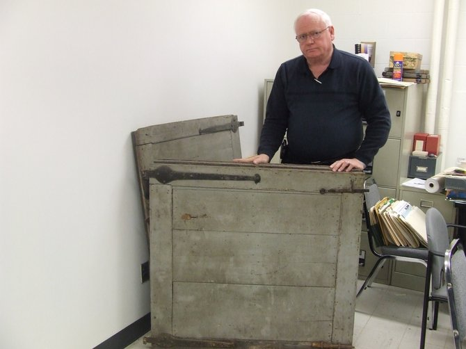 Town of Colonie Historian Kevin Franklin stands with the two parts of the door that once stood in the entrance way of the Schuyler Flatts home. The home was burnt down in 1962, but the door had been removed before the burning.