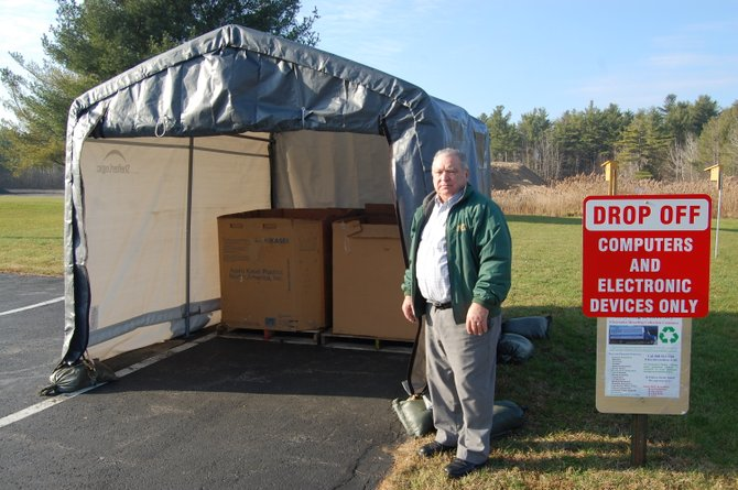 Champlain Town Supervisor Larry Barcomb standing near the Electronics Recycling Collection site.
