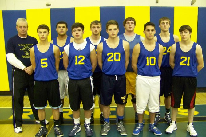 The 2012-13 Warrensburg High School Boys Basketball Team includes (front, left to right): Jeffrey Bentham, Jacob Nemec, Justin Baird, Joe Brunelle, Nick Perrone, (rear): Coach Bob Hummel, Tyler Wilcox, Nolan Maltbie, Adam Langworthy,and Shea Irish.