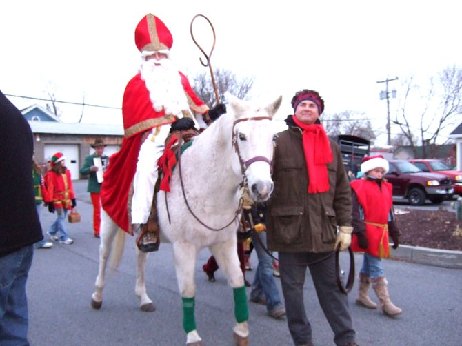 The arrival of St Nicolaas parading down Broadway in Schuylerville on his traditional white horse is a beloved part of that community's Festival of Trees.