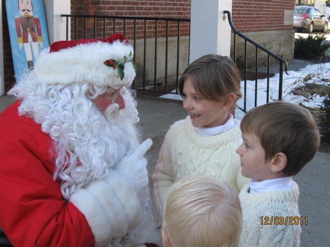 "Santa offers a little friendly advice about holiday behavior to  three children attending the 2011 edition of Christmas in Warrensburgh. Santa is to be back this Saturday Dec. 1 stationed at ""Toyland"" — the Warrensburg Town Hall — for the 2012 installment of the festival that annually celebrates traditional holiday spirit."