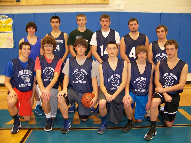 The 2012-13 Lake George High School Boys Basketball Team includes (front, left to right): Ethan Wincowski, Jeff Naftaly, Matt Bureau, Andrew Zibro, Tyler Brown, Connor McCoy, (rear): Zack Zayachek, Tyler Prime, Joel Wincowski, Greg Rosenthal, Nathan Fidd, and Alex Labruzzo.