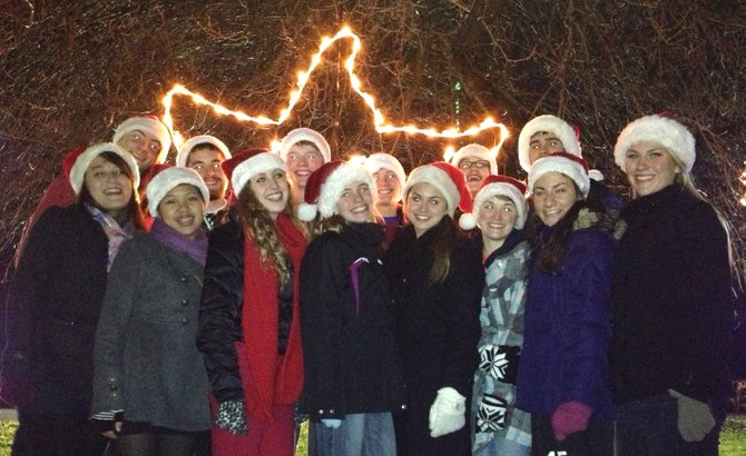 The Cazenovia Chamber Choir poses for a photo after caroling around Lights on the Lake Nov. 13.