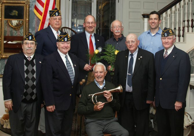 Pictured are the Post 88 Officers with Rotarian military veterans. In the back row stand Commander Jack Mott, left, beside veterans Fred Palmer, Lloyd Besaw and John Cayanne. In the front row are First Vice Commander Gene Gissin, Rotarian Robert Conway and Chaplain Al Keilen. Seated holding The American Ceremonial Bugle is Word War II veteran Fred Taylor.
