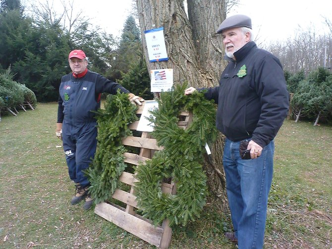 Ulrich Rudofsky, left, and Dan Ryan, co-organizers of the Bethlehem Lions Club annual Christmas tree sale, stand in the tree lot on Route 9W. The organization had 34 trees stolen Friday, Nov. 23.