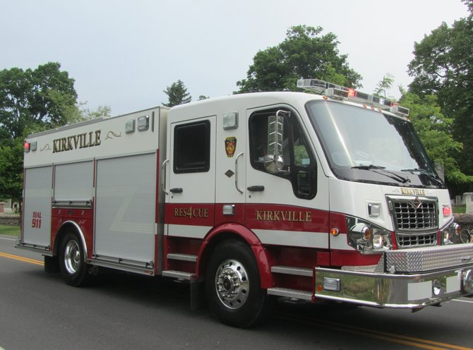 Kirkville volunteer firefighters drive a fire engine in Fayetteville's Memorial Day parade.