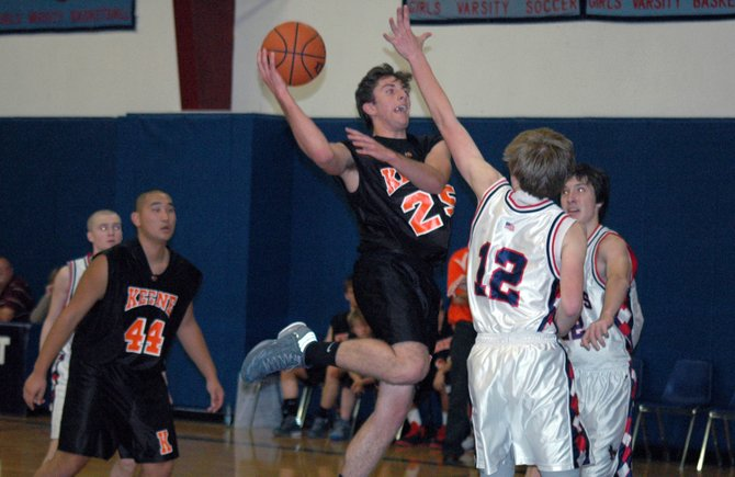 Colton Venner drives to the lane against Westport in the first varsity boys basketball game for the Beavers in three years.