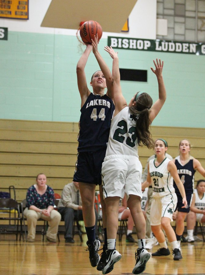 Skaneateles junior forward Joanna Dobrovosky (44) takes a jump shot over Bishop Ludden's Gemma O'Kane in Thursday night's game, a 79-36 Lakers victory. Earlier in the week, Dobrovosky had a triple-double (11 points, 13 rebounds, 10 blocks) as her team beat East Syracuse-Minoa 49-39.