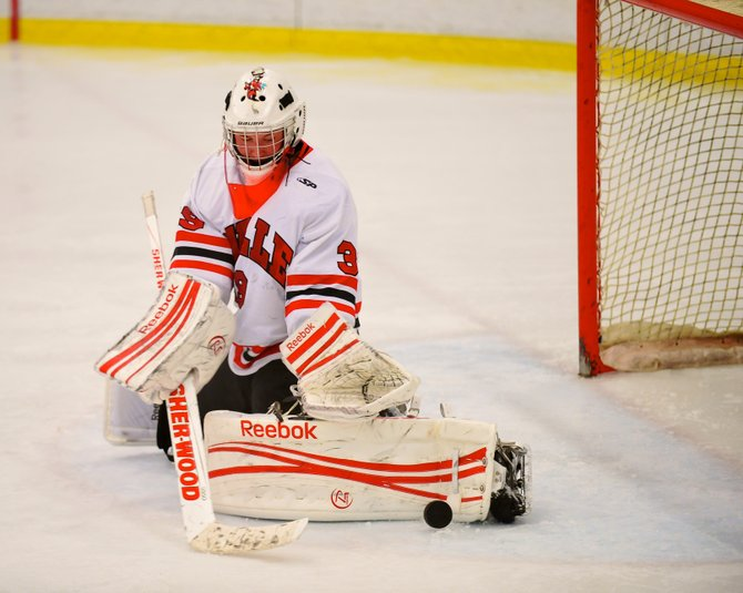 Baldwinsville senior goaltender Josh Pinard (39) makes one of his 25 saves in Tuesday night's 4-2 victory over Fayetteville-Manlius, which helped the Bees bounce back from a season-opening overtime defeat to Cazenovia.