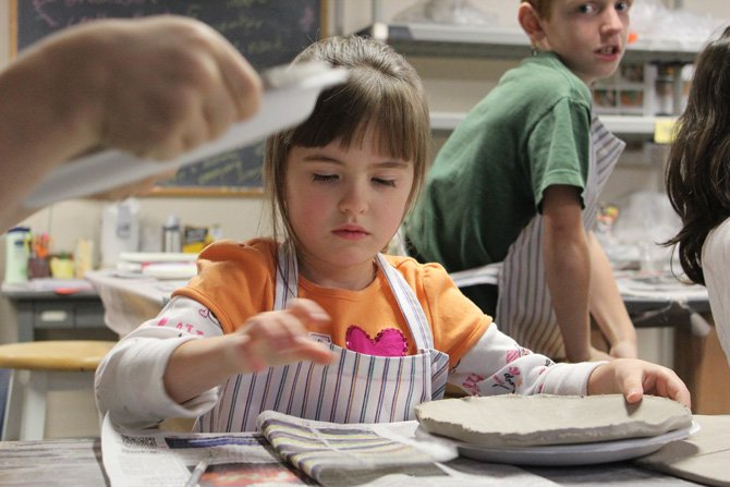 Abby Reeder gets ready to decorate her ceramic cookie plate at a holiday workshop at the North Country Cultural Center for the Arts in Plattsburgh.