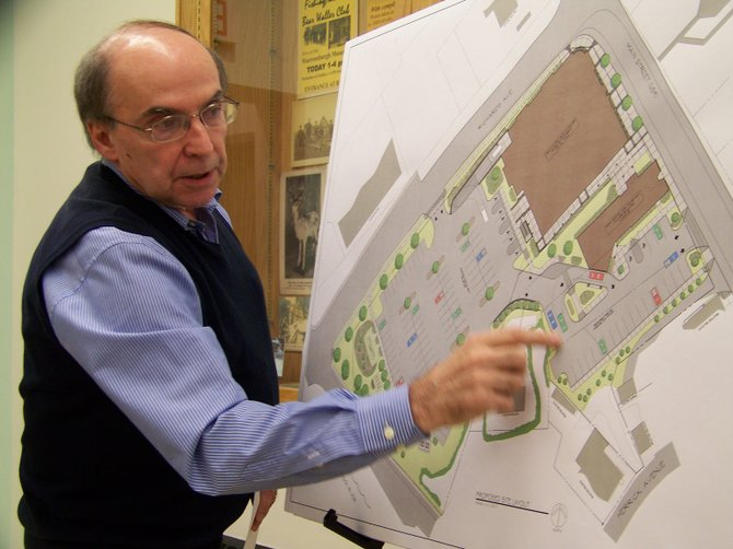 Architect Richard Jones explains the floorplan of  the new Warrensburg Health Center to the town Planning Board at their Nov. 20 meeting. The new main building, to be constructed next year, features many more exam rooms, a CAT scanner and about double the floorspace.