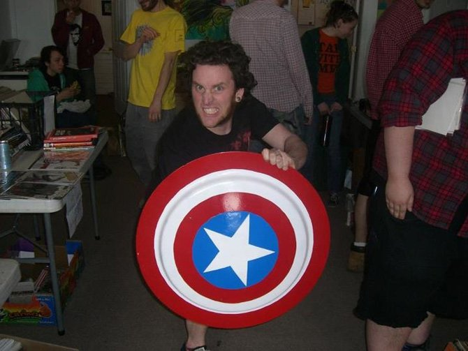 "Nick Dubay, ROTA Gallery Board member and singer for band ""Return of the Fly,"" poses at the first ROTCON with Captain America replica shield."