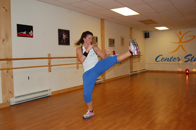  Jessica Coupal leads Turbo Kick. She and other instructors are raising funds and gifts this weekend for the Christmas Bureau.