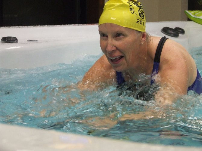 Ironman competitor Peggy Phillips tried the Michael Phelps Signature swim Spa, made by Master Spas, at Concord Pools in Latham on Wednesday, Nov. 28.