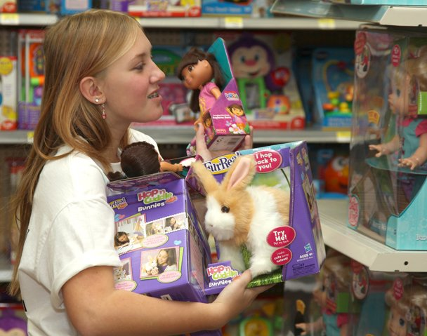 Skaneateles Middle School Student Kayla Ramsden shops for toys for needy children Wednesday, Dec. 5, at Walmart in Camillus.