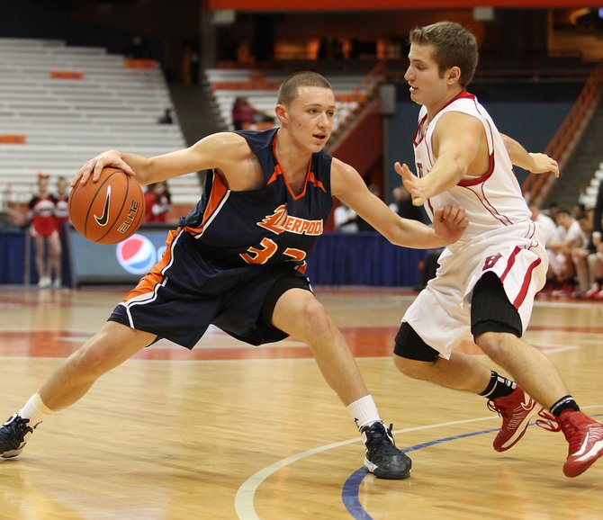 Liverpool freshman guard Tyler Sullivan (32) dribbles and works against Baldwinsville's Zach Leo (11) during Sunday's Tip-Off Classic at the Carrier Dome. Sullivan and the Warriors defeated the Bees 87-68 to improve to 2-0 on the season.
