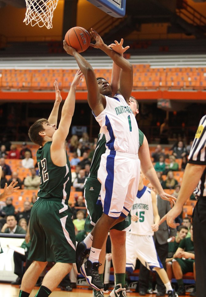 Cicero-North Syracuse forward Xavier Brown (1) gets an open look near the basket in Sunday night's game against Fayetteville-Manlius in the Tip-Off Classic at the Carrier Dome. Despite Brown's 10 points, the Northstars lost to the Hornets 73-48.