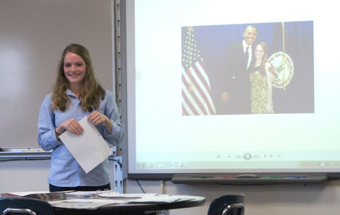 Caroline Marshall stands in front of Kurt Wheeler's Advanced Placement United States Government and Politics class on Dec. 4 in Cazenovia High School. She spoke to students of her recent experiences with the Obama campaign and meeting the president as well as her future plans at Harvard University.
