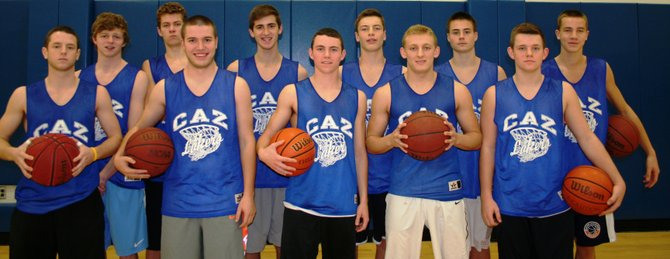 Cazenovia boys varsity basketball players pose for a group photo. From 5:30 to 8:30 p.m. Dec. 20, the team will host its second annual fundraiser, and serve dinner to community members at Dave's Diner.