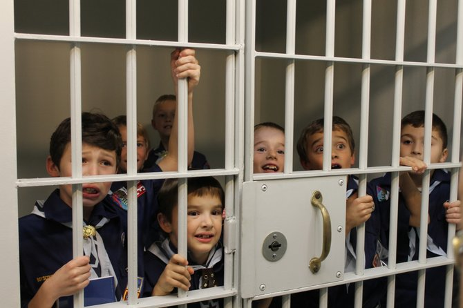 "F-M Cub Scouts tour the Manlius Police Department jail cell while earning their ""Law Enforcement is a Big Job"" achievement."