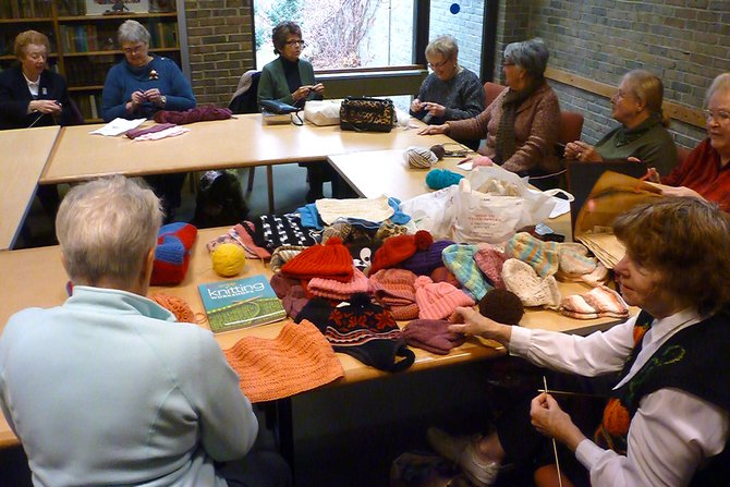 Each year, Delmar Progress Club's Knitting Group displays a Giving Tree in the lobby of the Bethlehem Public Library adorned with winter ware they made by hand throughout the year.